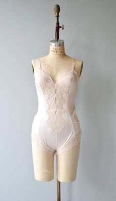 Vintage 1970s very very pale pink polyester romper with pretty lace center panel and side leg. ✂-----Measurements fits like: medium bust: 34-36 waist: 28-30 hip: up to 38.5 length: 28 brand/maker: n/a condition: excellent to ensure a good fit, please read the sizing guide: http://www.etsy.com/shop/DearGolden/policy ✩ more lingerie | swim ✩ https://www.etsy.com/shop/DearGolden?ref=hdr_shop_menu&section_id=7337122 ✩ visit...