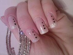 Cool french nails with 3 black dots