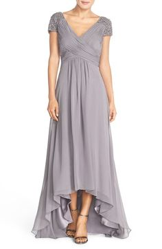 Free shipping and returns on Eliza J Beaded Shoulder Pleated Chiffon Gown at Nordstrom.com. Opulently embellished shoulders flank the finely pleated surplice bodice of a wispy Empire-waist chiffon gown featuring a floor-sweeping asymmetrical hem. Double V-necklines finish the look with alluring elegance.