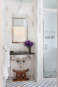 Interior Design by Anna Hackathorn, bathroom, powder room, guest bath, gray and white wallpaper, les indiennes, glass shower door, black counter top, ann saks tile, african stool, wood stool, www.annahackathorn.com