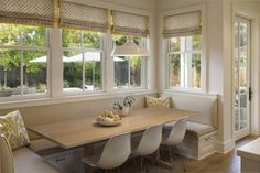 large banquette with Eames chairs
