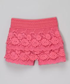 These flexible pull-on shorts boast floral lace tiers that add bohemian texture to an outfit.