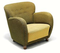 Flemming Lassen, attributed: Easy chair with patinated beech legs ...