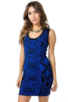 Get wild for the night! A mid-length bodycon dress, featuring a striking mirrored Art Deco-inspired geo print throughout. Open back with black ribbon trim. Deep scoop neck. Sleeveless. Finished hem. Knit. $34.90