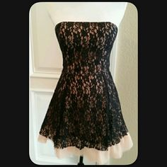 """💥SALE💥Black Lace & Tulle Dress Sexy short strapless dress with nude toned tulle and Black lace. Measures approximately 26"""" long. Waist 13.5"""" across not doubled. Padded Bust and lined. Hidden back zipper with hook and eye. Never worn. NWT Dress form is 34"""" - 35"""" bust, 26"""" waist, 33"""" hips,  2x Host Pick 😍 Very pretty in person. Price firm. Paid $150.00 + tax. PRICE FIRM 💟 Fable Dresses Strapless"""