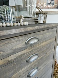 """To accomplish that weathered wood finish, I first rubbed Minwax """"Special Walnut"""" over the entire piece. Once that had completely soaked in, I rubbed a light coat of Rustoleum """"Weathered Grey"""" over the entire piece. Basically rubbing it off once I rubbed it on, because I didn't want to cover up the wood tone underneath."""