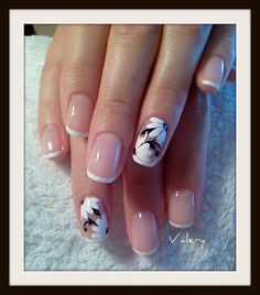 manicure - Have glowing looking nails with this elegant French tips. Using light pink as base, the nails are thinly tipped in white. The other nails are accented with white and black floral designs, which is pleasing to the eye. Flower Nail Designs, French Nail Designs, Flower Nail Art, Nail Art Designs, Nails Design, Floral Designs, French Manicure With Design, Nails With Flower Design, French Tip Design
