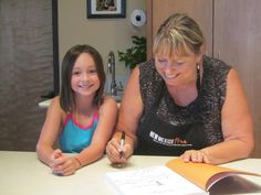 Cheryl Alters Jamison, chef, cookbook author and all-around-pal, is happy to sign her book for a young fun.