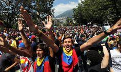 Student protesters in Venezuela shout anti-government slogans. (AP Photo/Fernando Llano)