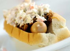"""""""The Dirty South"""" at Top of the Dog on Lisbon Street in Lewiston is a brown hot dog covered in pulled pork and cole slaw.    Buy a print"""