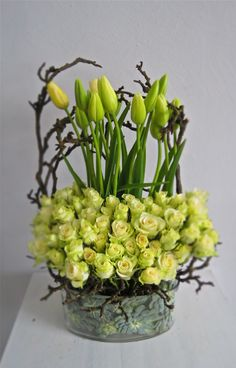 Modern floral display - playful french tulips combined with roses and some branches