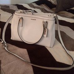 """Coach Madison Saffiano Mini Christie Carryall Coach Madison Saffiano Mini Christie Carryall, people always complimented me on this purse! They are no longer sold and seem to be high in demand! I totally loved this white and gold purse, I just prefer Michael Kors. It has SLIGHT discoloration from my jeans on the back side as pictured. I am open to trades but I am picky, I am looking for size 8.5-9 brown short uggs, a neutral colored MK, over the knee """"big calf friendly"""" boots, some high end…"""