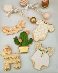 Love love these gold, light coral and green cookies! Larisa's Mexican Boho Baby Shower | CatchMyParty.com