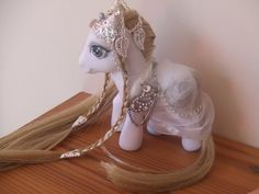 Google Image Result for http://fc02.deviantart.net/fs70/i/2012/120/5/9/elven_princess_my_little_pony_custom_by_lilacamy931-d4y2k33.jpg