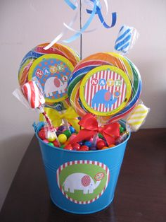 Buckets with childrens toys and mustaches as centerpieces on round tables