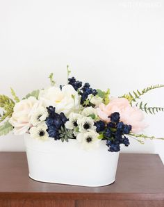Navy flowers, pink peonies and succulents make the perfect navy and pink flower arrangement for a wedding, Easter or spring table!