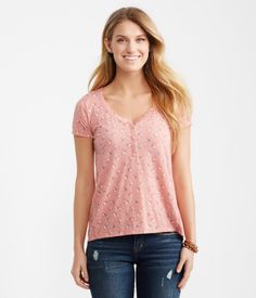 "Make every pleasant outing even more delightful in our Ditsy Floral Boxy Henley Tee! It's crafted of super-soft, lightweight material and features a scoop neckline with a pearlized-button placket. Throw it on with rolled shorties, then head out for a picnic.<br><br>Relaxed fit. Approx. length: 25""<br>Style: 9350. Imported.<br><br>70% polyester, 30% cotton.<br>Machine wash/dry.<br><br>Model height: 5'10.5"" 