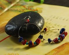 The Tibetan colorful stone earringsMaterial: natural colorful gravel, alloy beads, anti-allergic ear hookSpecifications: Body length about 5cm (excluding ear hooks)Style: handmadeWeight:13g/$9.99