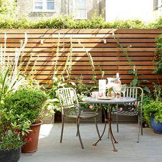Small garden patio with bistro table | Summer party patio ideas | Garden | Patio | PHOTO GALLERY | Housetohome.co.uk