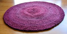 """I crocheted this rug with yarn I hand-cut from thrift store t-shirts and a sheet.  Measures 30"""" in diameter."""