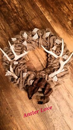 Antler burlap wreath I made for myself.I am hooked on antlers this year Antler Wreath, Burlap Wreath, Deer Horns, Diy Ideas, Craft Ideas, Winter Wreaths, Cabin Fever, Wreath Ideas, Wood Design