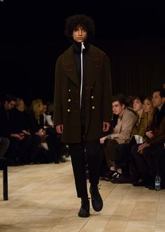 Dark green wool and cashmere military pea coat, layered over a tracksuit jacket and trousers