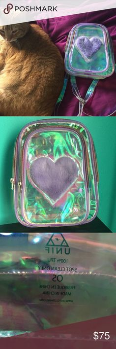Trixie Pack Super cute iridescent mini pack pack from UNIF 💜 Purchased earlier this year and only used 3 times. No flaws or signs of wear other than the natural bending/wrinkling of the material. All pics are mine! I'll only trade for UNIF in my ISO!!! CHEAPER ON DEPOP. UNIF Bags Mini Bags