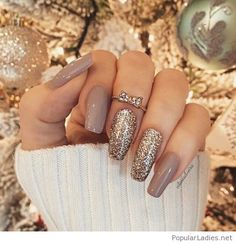 Grey gel manicure with glitter and rings