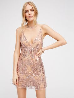 Night Shimmers Mini Dress | Shimmer and shine in this gorgeous mini dress featuring dazzling embellishments and eye-catching embroidery allover. Femme v-neckline and simple, sexy silhouette. Hidden side zipper closure. Lined.