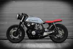 A 1982, Honda CB900f Super Sport, converted to a modern style cafe racer. Features include custom work by Goldenboyz Garage, fancy seat, and LED lighting conversion.