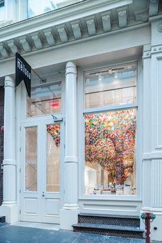 http://www.dezeen.com/2014/07/14/we-are-flowers-installation-softlab-melissa-shoe-shop-new-york/