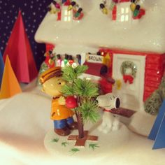 Charlie Brown & Snoopy are getting their tree ready. House and Figurine from Department 56.