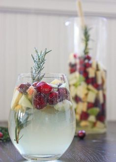 Cranberry & Rosemary White Christmas Sangria: 1 Granny Smith apple 1 Braeburn apple 1 heaping Cup Fresh cranberries 1 large Sprig rosemary 1 Bottle Pinot grigio ½ cup white grape juice ¼ cup sugar (more, for garnish) 1 Can club soda