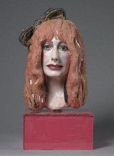 Mosaic portrait sculpture of Zandra Rhodes by Andrew Logan
