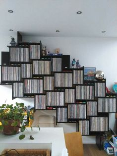 Gorgeous way to display all that vinyl - but you'll need some serious screws to hold those up!
