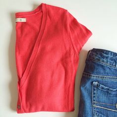Old Navy V-neck Button Cardigan Old Navy v-neck button down cardigan sweater in coral. Size XS, gently worn, pre-loved and in great condition! Old Navy Sweaters Cardigans