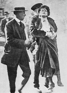 Suffragette Emmeline Pankhurst being arrested in 1914.  Meanwhile, in 1902: Australian women won the right to vote.