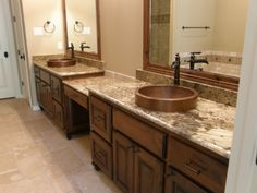Copper sinks, Delta Faucets, Alder stained cabinets and granite counters = SWEET!