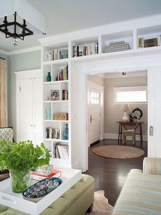 "Built ins define an entry via BHG. DIY Built-in IKEA Bookshelves: ""Built-in bookcases not only add a ton of character and storage, but they really can make a small house feel so much bigger!"" - love the colors in the living room and hallway Living Room Storage, Home Living Room, House, Interior, Home, Bookshelves Built In, Storage Furniture Living Room, House Interior, Bookcase Diy"