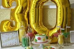 Mylar balloon numbers are the easiest way to make a statement with your backdrop!   CatchMyParty.com