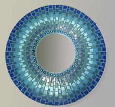 mosaic mirror, Beautifully designed. I wonder if it's curved, or the design just make it look like that?