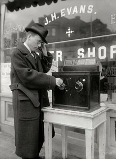 "Washington circa 1922. ""Coin-operated radio outside barbershop."