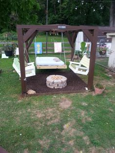 Our Oasis! Swings, fire pit and bed  we did rubber mulch!
