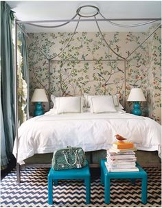 Don't be afraid of using patterns in a small room. This room ban barely fit the bed yet it looks large and inviting.