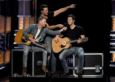 Luke Bryan Photos Photos - Co-hosts Dierks Bentley (L) and Luke Bryan (C) speak as a wax figure of Luke Bryan is displayed onstage during the 52nd Academy Of Country Music Awards at T-Mobile Arena on April 2, 2017 in Las Vegas, Nevada. - 52nd Academy of Country Music Awards - Show