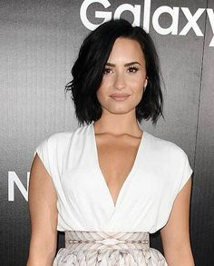 10 Sophisticated and Sexy Short Hairstyles: #10. Demi Lovato Dark Colored Thick Style for Short Hair
