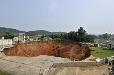 Sinkhole first appeared in January 2010, and by June had grown to 492 feet wide and 164 feet deep.  Hunan Province, China