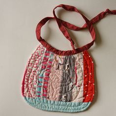 quilted bib ..cute as a bib.,..I thought it was an apron....which would be cute too!