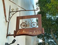 Shop sign in Carmel-by-the-sea, CA.