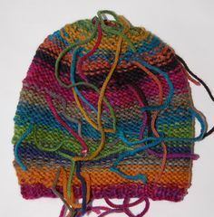 Itty-Bitty Little Bit Hat | Creative Knitting Blog (like the colors...but -is it unfinished? inside out? suposed to be hairy looking?)